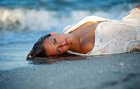beach girl lying on the waters edge