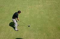 High angle view of a man playing a golf shot