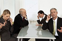 Group of businesspeople talking on cell phones