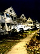 Late ninteenth century houses on a curved street are captured at night with a slight blur in New England. USA