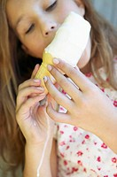 Girl eating an ice cream cone (thumbnail)