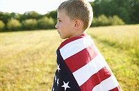 Boy draped in the American flag (thumbnail)