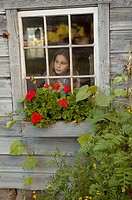 Girl looking out a window (thumbnail)