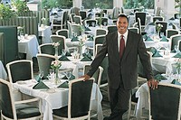 Businessman at empty restaurant, portrait.