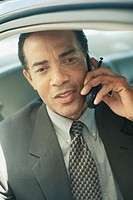 BUSINESS MAN IN CAR WITH CELL PHONE