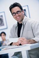 Man paying bills online, portrait.
