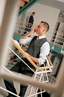 Businessman talking on phone.