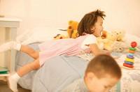 Children playing in bedroom.