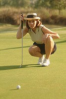 Woman playing golf.