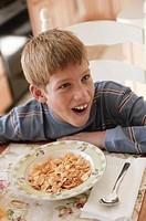 Boy eating breakfast.