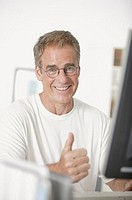 Man at computer, portrait.