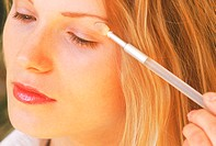 Close up of a Woman Applying Eye Makeup
