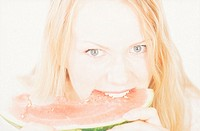 Portrait of Young Blonde Woman Eating Water Melon