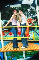 Two Teenage Girls in Amusement Park