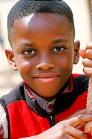 Portrait of a young boy looking at camera (thumbnail)