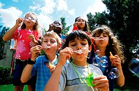 Young children blowing soap bubbles (thumbnail)