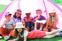 Young children in a tent