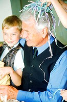 Close-up of a grandfather smiling at grandson