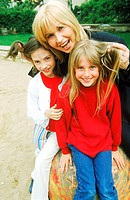 Portrait of mature adult with two young girls (thumbnail)