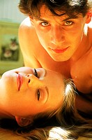 Close-up of a young couple lying together (thumbnail)