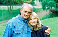 Portrait of a mature couple holding each other smiling