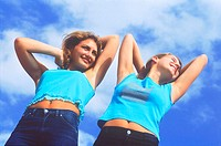 Two young women stretching outdoors (thumbnail)