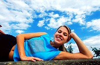 Young woman exercising outdoors (thumbnail)
