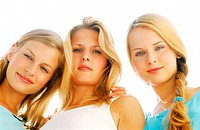 Low angle view of three young women looking down