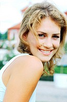 Young woman looking at camera and smiling (thumbnail)