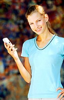 Young woman holding a mobile phone (thumbnail)