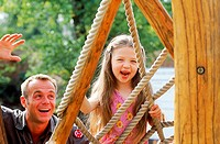 Father and daughter playing on a jungle gym (thumbnail)
