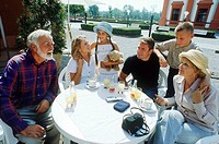 Family at a breakfast table outdoors