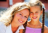 Portrait of mother and daughter smiling