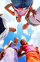 A group of young people looking down (thumbnail)