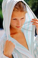 Young woman wearing a hooded bath robe
