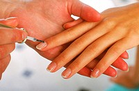 Close-up of a woman's finger nails being painted