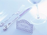 Close Up of a Knife and Fork and Wineglass