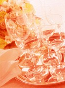 Close Up of Stemmed Wineglasses of Serving Tray with Roses