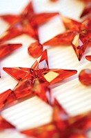Close-up of star shaped Christmas ornaments
