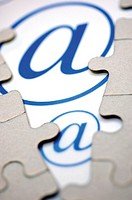 Close-up of jigsaw puzzle over an 'at' symbol (thumbnail)