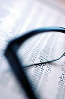 Pair of eyeglasses on a financial page