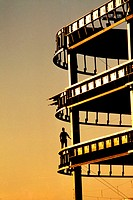 Silhouette of Construction supervisor inspecting high rise