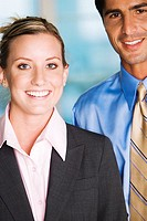 Portrait of a businessman and a businesswoman smiling (thumbnail)