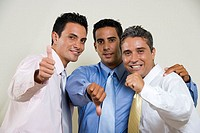 Portrait of three businessmen gesturing thumbs up