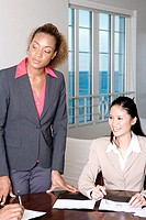 Close-up of two businesswomen in a meeting