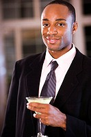 Portrait of a businessman holding a martini glass