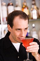 Close-up of a mid adult man drinking a cocktail