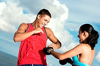 Low angle view of a young couple sparring