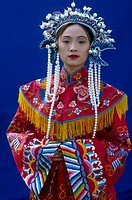 Portrait of woman wearing traditional clothing, China