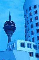 Low angle view of communication tower with office buildings, Neuer Zollhof, Dusseldorf, North Rhine_Westphalia, Germany